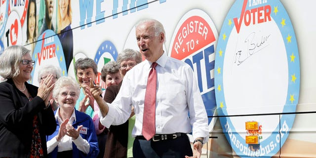 Sept. 17, 2014: Vice President Joe Biden reacts after signing the Nuns on the Bus tour bus during a stop in Des Moines, Iowa.