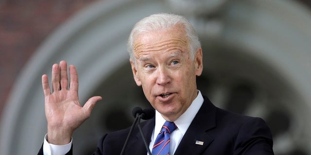 FILE - In this May 24, 2017, file photo, former Vice President Joe Biden delivers the annual Harvard College Class Day address on the campus of Harvard University, in Cambridge, Mass. Just days after launching a new political action committee, former Biden will join Republican officials and donors at a weekend retreat hosted by former GOP presidential nominee Mitt Romney. (AP Photo/Steven Senne, File)