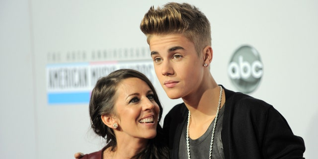 Nov. 18, 2012: In this file photo, Justin Bieber, right, and Pattie Mallette arrive at the 40th Anniversary American Music Awards, in Los Angeles.