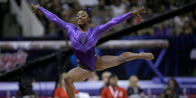 Simone Biles competes on the floor exercise during the women's U.S. Olympic gymnastics trials in San Jose, Calif., Friday, July 8, 2016. (AP Photo/Ben Margot)