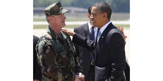 In this May 6, 2011, file photo President Barack Obama talks with U.S. Navy Vice Admiral William H. McRaven in Fort Campbell, Ky., just days after McRaven led operational control of Navy SEAL Team Six's successful mission to get Osama bin Laden.