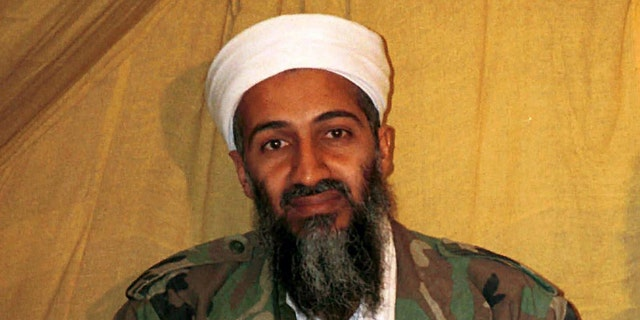 FILE - This undated file photo shows al Qaida leader Osama bin Laden in Afghanistan. A federal appeals court is backing the U.S. government's decision not to release photos and video taken of Osama bin Laden during and after a raid in which the terrorist leader was killed by U.S. commandos. The three-judge panel of the U.S. Circuit Court of Appeals for the District of Columbia turned down an appeal Tuesday from Judicial Watch, a conservative watchdog group, which had filed a Freedom of Information Act request for the images.  (AP Photo, File)