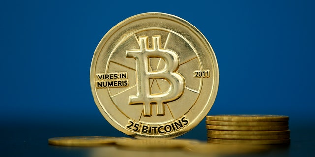 Bitcoin (virtual currency) coins are seen in an illustration picture taken at La Maison du Bitcoin in Paris, France, May 27, 2015.