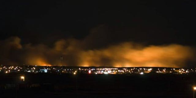Jan.4: Smoke and fire rise over Browning, Mt.