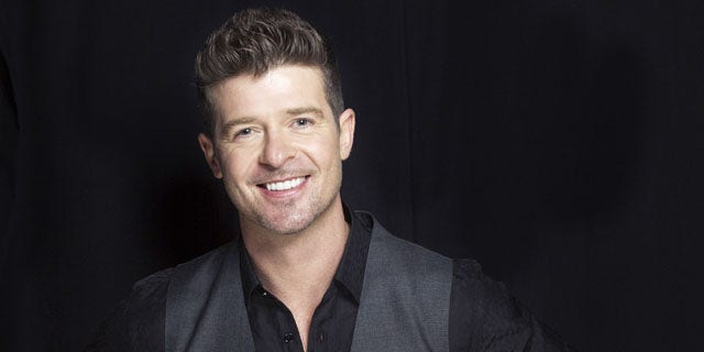 "FILE - This Aug. 1, 2013 file photo shows R&B singer-songwriter Robin Thicke in New York. Two of Marvin Gaye's children, Nona and Frankie Gaye, countersued Thicke and his collaborators on the hit song ""Blurred Lines"" on Wednesday in Los Angeles claiming the singers improperly copied their father's hit ""Got to Give It Up."" (Photo by Victoria Will/Invision/AP, File)"