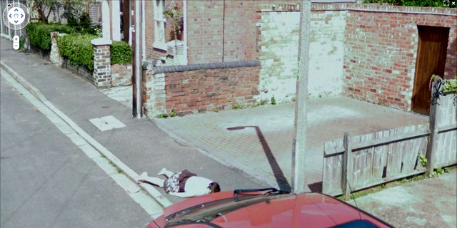 A young English girl pranked her friend by playing dead, when a Google Street View car happened by, preserving the moment and disturbing neighbors.
