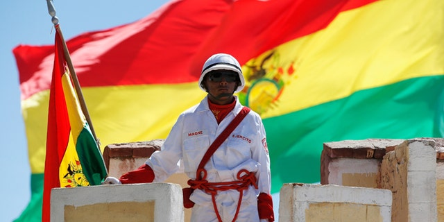 UYUNI, BOLIVIA - JANUARY 11:  A soldier at Denodado y Aguerrido RI-4 LOA Military Base stands at attention during Day 7 of the 2014 Dakar Rally on January 11, 2014 in Uyuni, Bolivia.  (Photo by Dean Mouhtaropoulos/Getty Images)