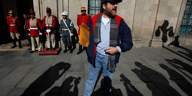 FILE - In this May 23, 2013 file photo, Jacob Ostreicher, a New York businessman, arrives to the government palace to deliver a letter to Bolivia's President Evo Morales in La Paz. Bolivia's government expressed outrage over Ostreicher's mysterious departure from the Andean nation, calling him a fugitive who sneaked across the border into Peru with the help of unknown groups. (AP Photo/Juan Karita, File)