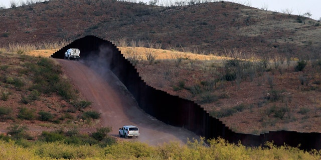 U.S. Border Patrol agents patrol the border fence near where a U.S. Border Patrol agent Nicholas Ivie was shot and killed, and one other was shot and injured, in Naco, Arizona
