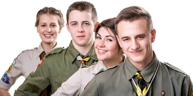Four young scout boys standing in uniform