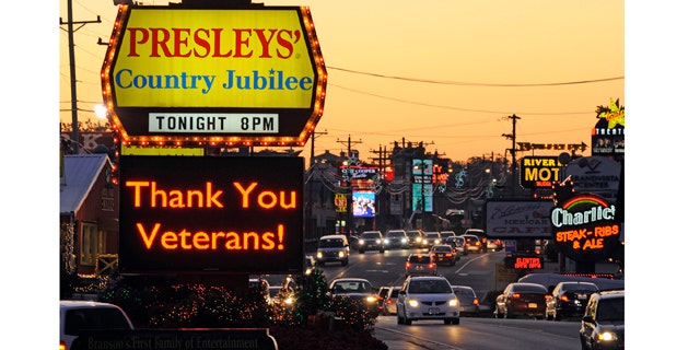 A music venue flashes an electronic marquee thanking military veterans in Branson, Missouri, November 9, 2011. The Midwestern entertainment-centered town in the Ozarks caters to veterans in the days leading up to Veteran's Day on November 11. Picture taken November 9, 2011. REUTERS/Dave Kaup (UNITED STATES - Tags: MILITARY SOCIETY ANNIVERSARY)