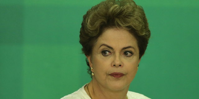 Brazil's President Dilma Rousseff arrives at a press conference after impeachment proceedings were opened against her by the President of Chamber of Deputies Eduardo Cunha, at the Planalto Presidential Palace in Brasilia, Brazil, Wednesday, Dec. 2, 2015. The speaker of the nation's lower house says he's opening the impeachment process based on accusations that Rousseff's government broke fiscal responsibility laws this year. (AP Photo/Eraldo Peres)