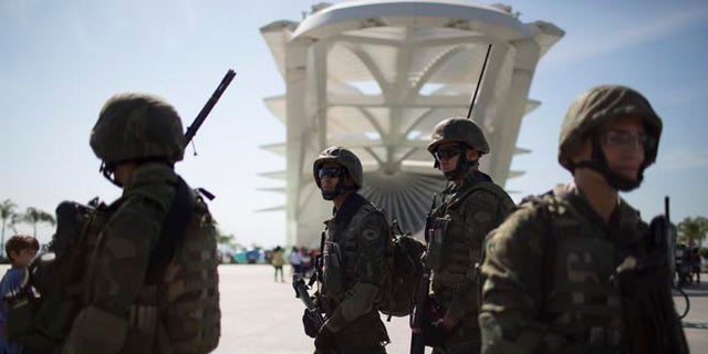 Soldiers stand guard in front of the Museum of Tomorrow in Rio de Janeiro, Brazil, Saturday, July 9, 2016.
