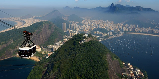 RIO DE JANEIRO, BRAZIL - JUNE 07:  A view of the city as a cable car heads up Sugar Loaf Mountain ahead of the of FIFA Confederations Cup Brazil 2013 on June 7, 2013 in Rio de Janeiro, Brazil.  (Photo by Michael Regan/Getty Images)