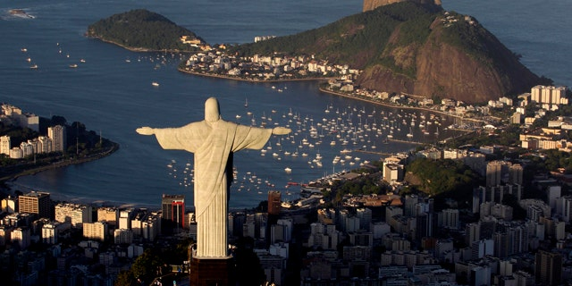 FILE 2011: The statue of Christ the Redeemer is seen with the Sugar Loaf mountain at back in Rio de Janeiro, Brazil.