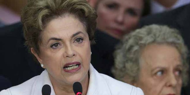 Brazil's President Dilma Rousseff addresses the nation at Planalto presidential palace in Brasilia, Brazil, Thursday, May 12, 2016.