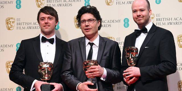 From left, Brian J. Falconer, Ronan Blaney and Michael Lennox, winners of the Best Short film, Boogaloo and Graham,  pose for photographers in the winners room, during the British Academy  Film and Television Awards 2015, at the Royal Opera House, in London, Sunday, Feb. 8, 2015. (Photo by Jonathan Short/Invision/AP)