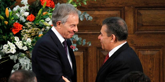 Former British Prime Minister Tony Blair, left talks to Mohammed J Al-Doreky, Iraq Deputy Foreign Minister after addressing the delegates, at the Iraq Britain Business Council (IBBC) fourth annual conference in central London, Monday, Nov. 5, 2012. Former Prime Minister Tony Blair says British forces should be proud of their role in the U.S.-led invasion of Iraq, citing what he claimed is major progress made in the country since the toppling of Saddam Hussein in 2003. (AP Photo/Sang Tan, Pool)