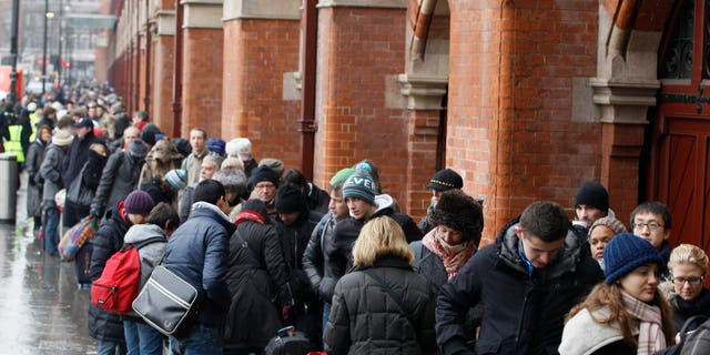 Passengers queue for Eurostar trains at St Pancras station in London, Tuesday, Dec. 21, 2010. Major delays and cancellations caused by cold and snow disrupted European airports including London's Heathrow, and the Eurostar train link, leaving thousands stranded across Europe as Christmas approached