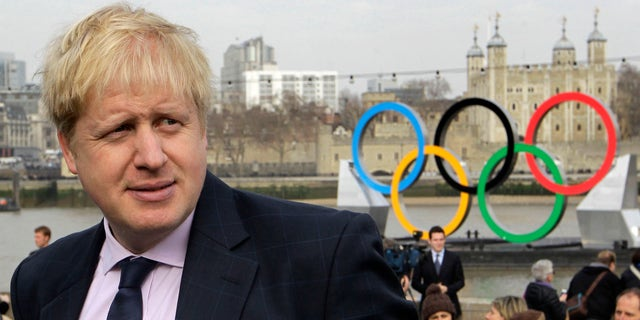 Feb. 28, 2012: This file photo shows mayor of London Boris Johnson as he waits for a giant Olympic Rings to start its journey down the River Thames in London to mark 150-days until the start of the London 2012 Olympic games.