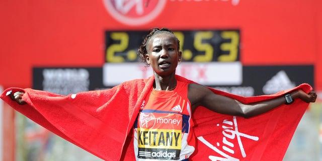 April 22, 2012: Kenya's Mary Keitany celebrates winning the women's race during the 2012 London Marathon for the second year during the 32nd London Marathon in London.