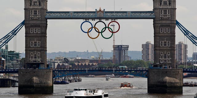 June 27, 2012:This file photo shows the Olympic rings atop the iconic Tower Bridge over the river Thames in London, with one month to go until the start of London 2012 Games.