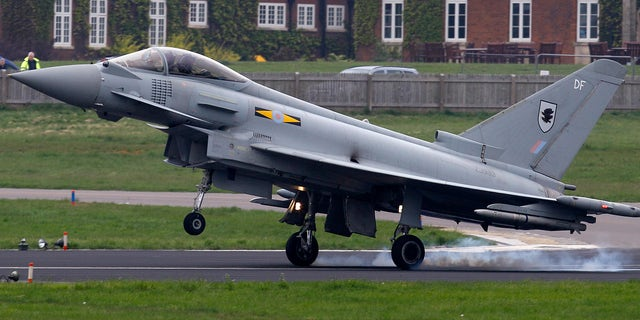 May 2, 2012: An RAF Typhoon fighter aircraft lands at RAF base Northolt, where four of the aircraft will be based as part of the Olympics related security exercise in west London.