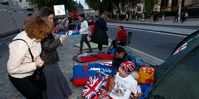April 26: John Loughrey, a fan of Princess Diana, talks with a passer-by outside Westminster Abbey in London. (AP)
