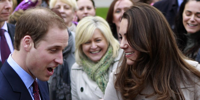 In this Tuesday, March 8, 2011 file photo, Britain's Prince William and Kate Middleton prepare to flip pancake at a display by the charity Northern Ireland Cancer Fund for Children outside the City Hall in Belfast, Northern Ireland.