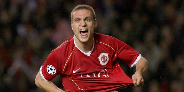 FILE - This is a Wednesday Dec. 6, 2006  file photo of Manchester United's Nemanja Vidic as he celebrates scoring against Benfica during their Group F Champions League soccer match at Old Trafford, Manchester, England. Inter Milan said Wednesday March 5, 2014  Manchester United defender Nemanja Vidic will join the club for the start of next season.  (AP Photo/Steven Governo, File)