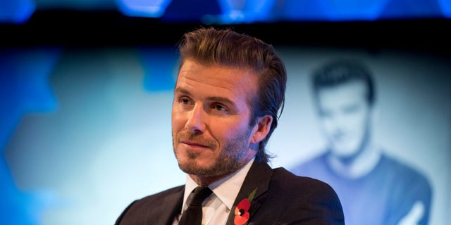 """Former England national soccer team captain David Beckham listens to a question as he is interviewed by The Associated Press at a studio in Hampstead, north London, Wednesday, Oct. 30, 2013.  Beckham was promoting his new photography book entitled """"David Beckham"""".  (AP Photo/Matt Dunham)"""