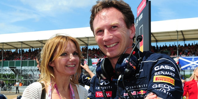 FILE - In this June 30, 2013 file photo Red Bull team principal Christian Horner and Geri Halliwell stand on the grid before the British Grand Prix at Silverstone Circuit, England. Halliwell, 42, says in a notice Tuesday Nov. 11, 2014 in the Times of London that she will wed Red Bull team principal Christian Horner, 40. The announcement did not say when the wedding is to take place. (AP Photo/PA, Anna Gowthorpe, File) UNITED KINGDOM OUT  NO SALES  NO ARCHIVE