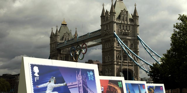July 23, 2012: Enlarged images of Royal Mail's Welcome to the London 2012 Olympics stamps are displayed at Potters Fields, London .