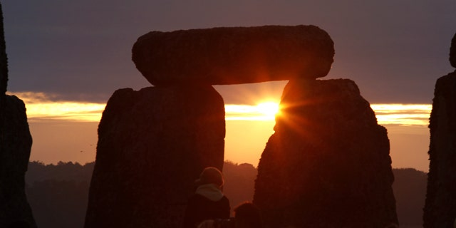 June 21, 2010: The sun rises behind the Stonehenge monument in England, during the summer solstice shortly after 04.52 am, Monday.