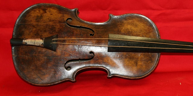 This undated photo provided by Henry Aldridge shows the violin that was played by the bandmaster of the Titanic as the oceanliner sank, Devizes, England.
