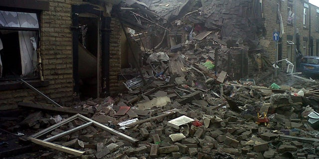 June 26, 2012: Damaged houses are seen  at the scene of a suspected gas explosion in the Shaw area of Oldham England.