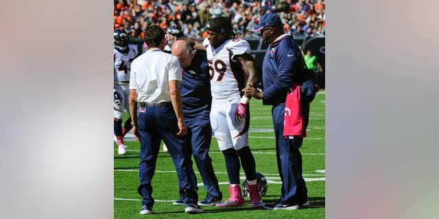 Denver Broncos outside linebacker Danny Trevathan (59) is helped off the field in the first quarter of an NFL football game against New York Jets, Sunday, Oct. 12, 2014, in East Rutherford, N.J. The Denver Broncos await test results on  Trevathan's left leg, the same one he fractured in training camp. (AP Photo/Bill Kostroun)