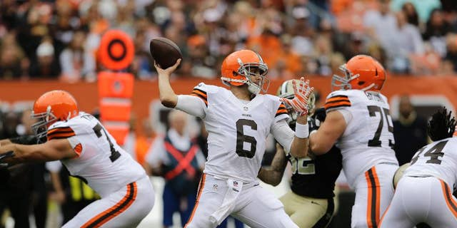 FILE - In this Sept. 14, 2014, file photo, Cleveland Browns quarterback Brian Hoyer (6) passes against the New Orleans Saints in an NFL football game in Cleveland. With two Pro Bowlers, an impressive rookie, a journeyman guard and right tackle who became a scapegoat last season, Cleveland's offensive line has been the team's strength so far this season. The unit has protected Hoyer and paved the way for one of the league's best running games.(AP Photo/Tony Dejak, File)