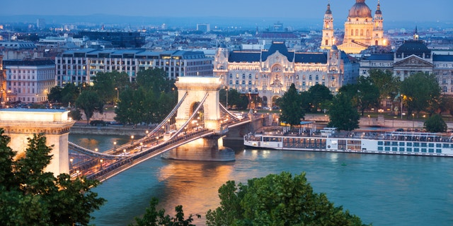 Panorama with Chain Bridge, St. Stephen's Basilica with lights in the evening in Budapest, Hungary