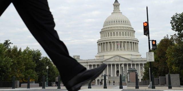 October 1, 2013: People walk near Capitol Hill in Washington. (AP Photo)
