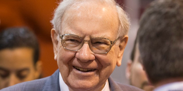 FILE - In this May 2, 2015, file photo, Berkshire Hathaway Chairman and CEO Warren Buffett smiles while touring the exhibit floor before presiding over the annual shareholders meeting in Omaha, Neb.