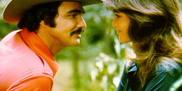 "Burt Reynolds and Sally Field in the 1977 film ""Smokey and the Bandit."""