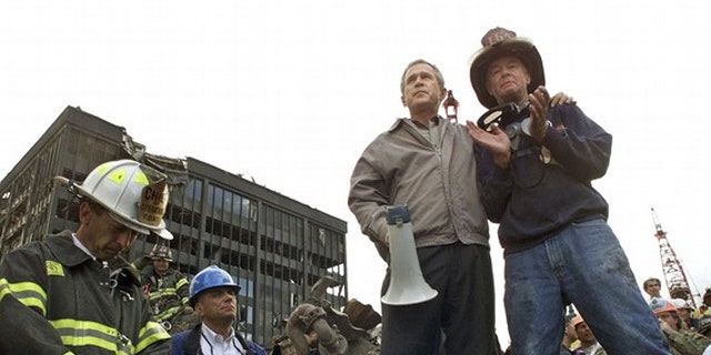 Sept. 14, 2001: President George W. Bush addresses rescue workers at Ground Zero