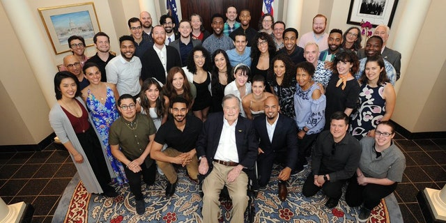 "The 41st president seen posing with the cast and crew of ""Hamilton."""
