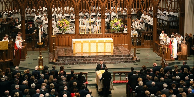 Barbara Bush's casket is brought to the altar on Saturday, April 21, 2018.