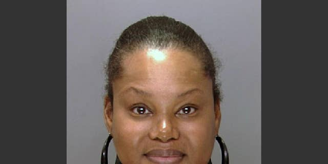 """FILE - This undated file photo provided by the Philadelphia Police Department shows Padge Gordon, also known as Padge Victoria Windslowe. Windslowe, an aspiring hip-hop artist who boasts about her talent for underground """"body sculpting,"""" has one last chance to impress a jury before the panel weighs murder charges against her in a dancer's death. Windslowe has been testifying since Thursday, Feb. 26, 2015, and faces more cross-examination this week. (AP Photo/Philadelphia Police Department, File)"""