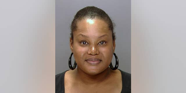 """FILE - This undated file photo provided by the Philadelphia Police Department shows Padge Gordon, also known as Padge Victoria Windslowe. An aspiring rapper known as """"the Black Madam,"""" Windslowe is accused of killing a 20-year-old dancer from London during a procedure that involved silicone buttocks injections and Krazy Glue.  Her third-degree murder trial is expected to start Thursday, Feb. 19, 2015 in Philadelphia Common Pleas Court.  (AP Photo/Philadelphia Police Department, File)"""