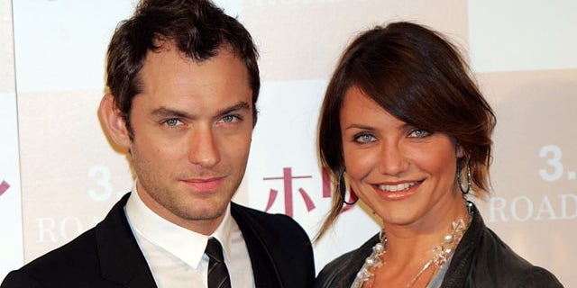 """TOKYO - MARCH 14: Actress Cameron Diaz and actor Jude Law attend a photo call and press conference to promote their latest film """"The Holiday"""" at Park Tower Hall on March 14, 2007 in Tokyo, Japan."""