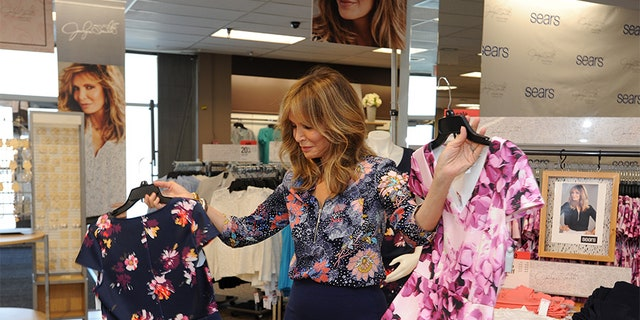 Jaclyn Smith admires her new clothing collection at Sears.
