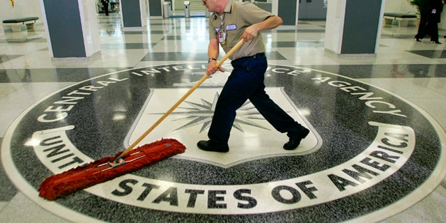 March 3, 2005: A workman quickly slides a dustmop over the floor at the Central Intelligence Agency headquarters in Langley, Va., near Washington.